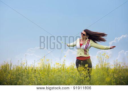 Beautiful Girl Enjoying The Sunny Day In The Wheat Field