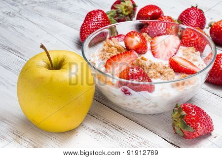 Milk, Cereal, Apple And Strawberries On A Wooden Table.