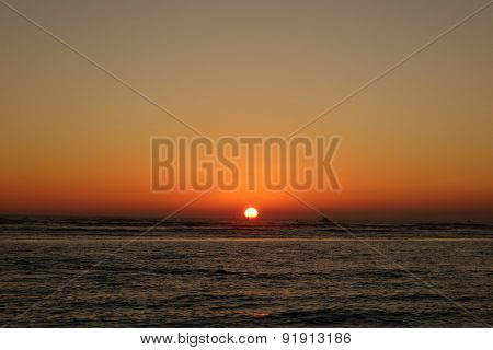 Boats And Buoy In The Water During Sunset Over The Ocean