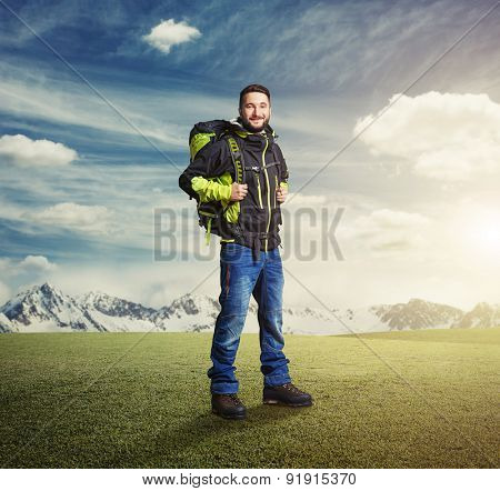 happy tourist with knapsack smiling and looking at camera over beautiful landscape