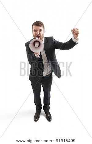 top view of angry screaming businessman with megaphone showing fist and looking at camera. isolated on white background