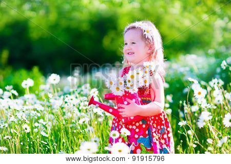 Little Girl In Daisy Flower Field