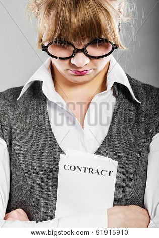 Stressed Business Woman Holding Contract In Hands