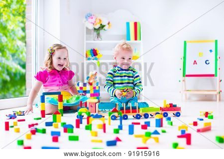 Kids Playing At Day Care With Wooden Toys