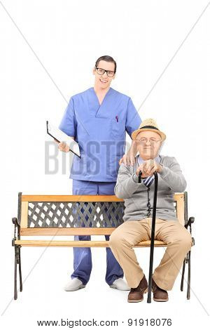 Full length portrait of a young doctor and a senior gentleman posing isolated on white background