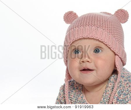 baby girl child  smiling happy pink fashion portrait face studio shot isolated on white caucasian hat warm clothing