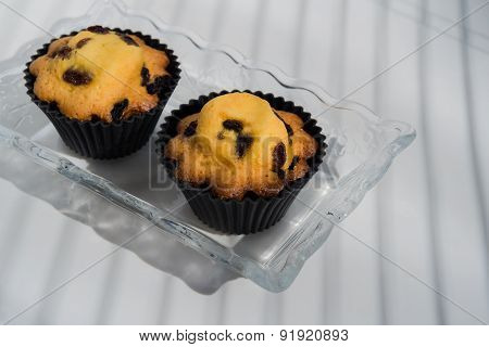 Aerial View Two Cupcakes On Vintage Glass Plate White Background