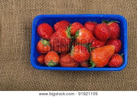 Aerial View Fresh Aromatic Strawberries In Blue Supermarket Plastic Tray
