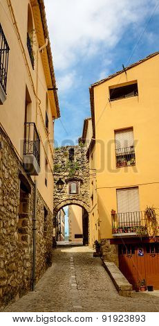Narrow street with arch at end in medeival town of Besalu