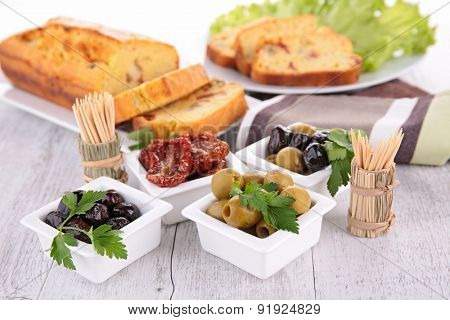 appetizer, loaf cake and olives