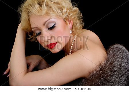Woman With Closed Eyes Lying With Fur