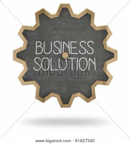 Business solution on gear shape blackboard