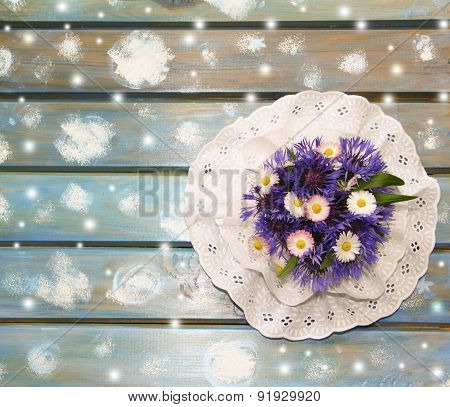 Lovely Paper Snowflakes And A Bouquet Of Flowers On A Blue Wooden Table, A Christmas Background