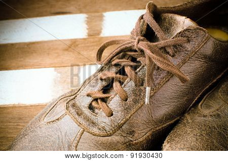 Old leather shoes on wooden background