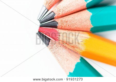 Red Pencil Among Other Pencils On White Background