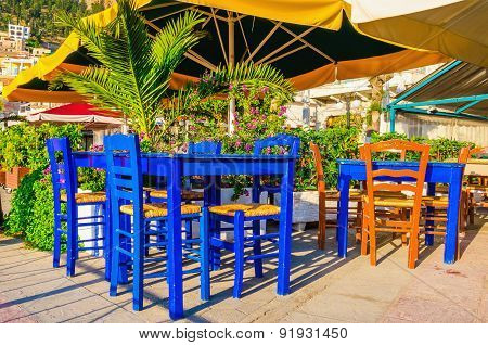 Blue wooden tables and chars in restaurant