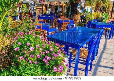 Wooden blue table and chairs in Greek restaurant