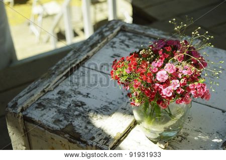 Beautiful flowers in a vase on an old table