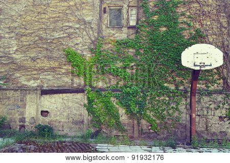 An old playground with broken basketball hoop