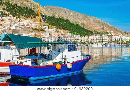 Blue wooden boat in peaceful port