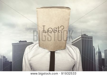 Businessman with a paper bag on head with lost text