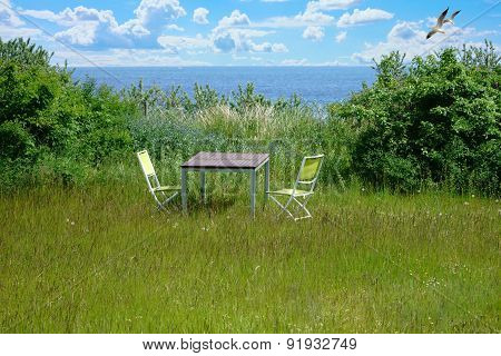 Garden Furniture On A Green Lawn