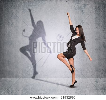 Businesswoman with shadow showing devil side