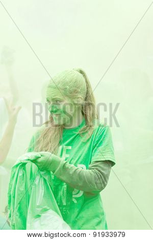 Young Girl Compleatly Covered With Green Color Powder