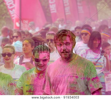 Lots Of People Covered With Pink Color Powder
