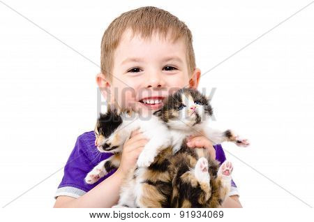 Portrait of a happy child with kittens in the hands