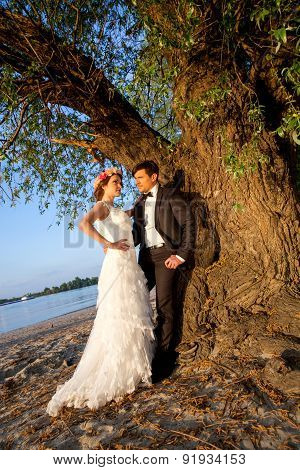 Wedding Couple Happy Below The Tree To The River Bank
