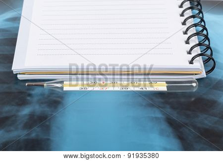 X-ray examination and copy book with thermometer