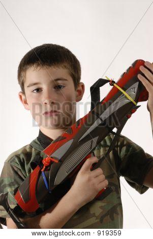 Young Boy Toy Gun
