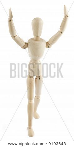 Wooden Manequin Raises His Arms To The Sky
