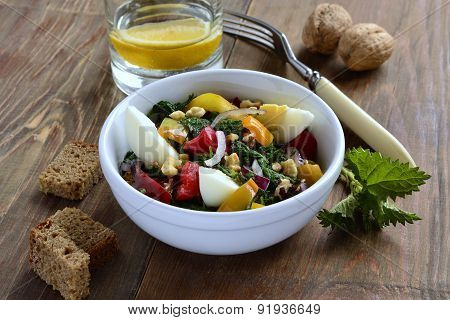 Salad with nettles egg sweet pepper onion and walnut