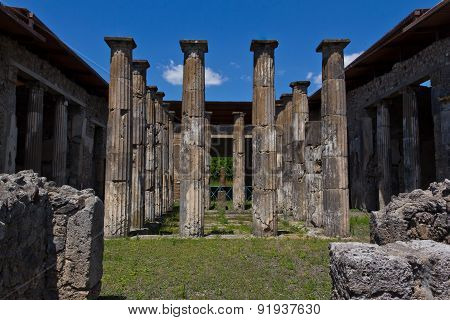 Stone Columns In The Main Courtyard Of A House In Pompeii