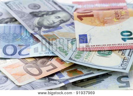 Money background - US dollars and euro banknotes