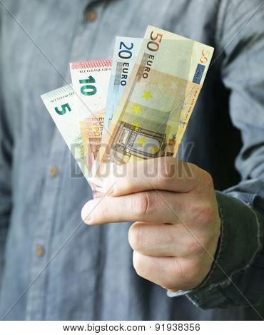 businessman hands holding european money (euro) - business, people, finances and money concept