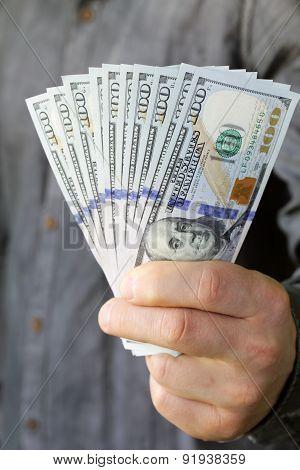 businessman hands holding dollar cash - business, people, finances and money concept
