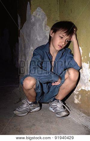 little boy in a dark cellar