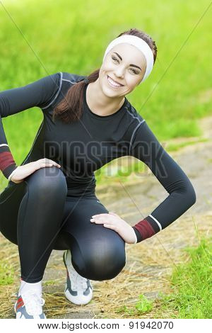 Portrait Of Young Fitwoman Resting Outdoors In The Park.