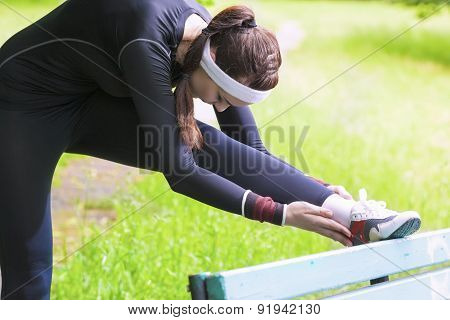 Young Caucasian Woman Having Stretching Exercises Outdors