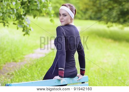 Happy Smiling Caucasian Sportswoman In Fitness Jogging Gear Outdoors Relaxing After Her Training