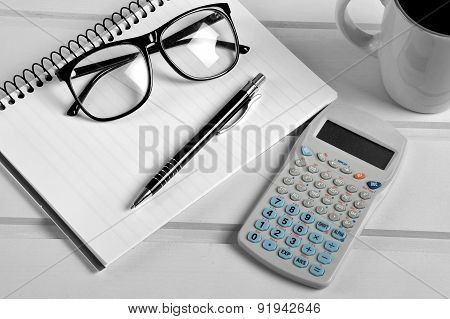 Notebook Pen Eyeglasses And Calculator