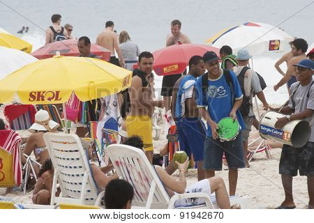 People Enjoying The World Famous Copacabana Beach In Rio De Janeiro Brazil