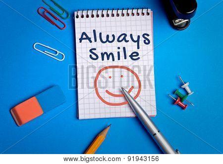 Always Smile Word On Notebook