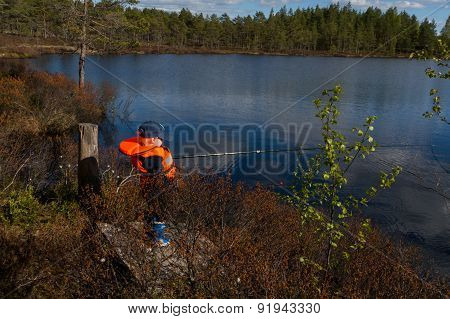 Young Boy Fishing In Sunlight