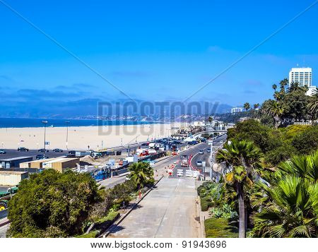 Many People Sunbath On The Sand Beach