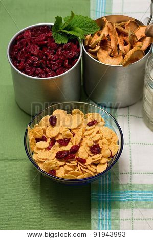 Upper View On Glass Bowl Full Of Cornflakes With Berries