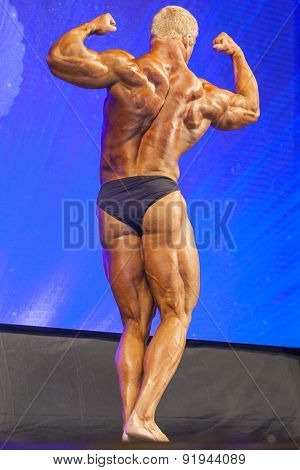 Minsk-belarus, April, 26: Professional Male Caucasian Bodybuilder Performing On Stage During Bodybui